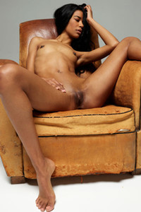 Angelique skinny chick exhibits her fresh young body with small tits on the leather armchair