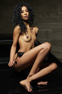All natural ebony Angelique leaves us speechless with seductive undressing and body presenting
