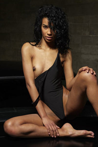 Magnificent ebony babe Angelique strips naked and dazzles us with her smooth body