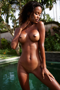 Exotic ebony hottie sits on the poolside presenting her tight athletic body