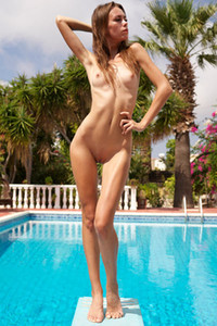 Irresistible slender doll flaunts her sexy body by the pool