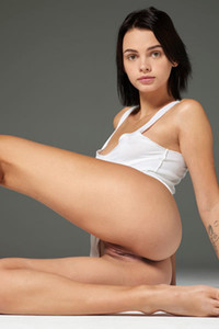 Adorable and playful girl Ariel she spreads her legs wide open baring her sweet  pussy