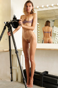 Tempting brunette doll exposes her sexy slender body in the photo studio