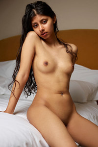 Graceful tanned damsel Anaya exposes her delightful body on top of the bed