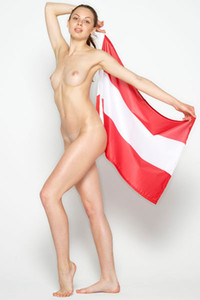 Incredibly hot and sweet skinny doll poses naked covered with flags