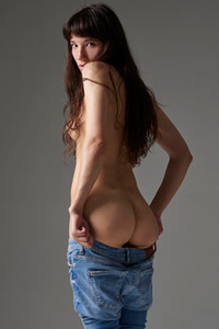 Mesmerizing brunette honey strips her denim pants to show us her amazing ass