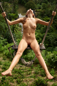 Brunette angel with nice body curves having a great time on the swing totally naked