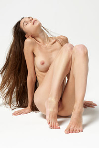 Fantastic young brunette Leona shows off her delightful pale body