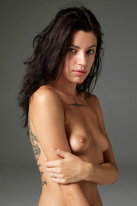 Astonishing dark haired model seductively poses naked showing off all she has