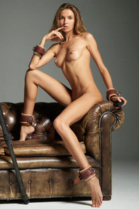 Alya gives all she has to the camera objective as she poses on the leather couch