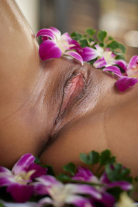Asian girl gives us a perfect look at her sweet twat covered with fresh flowers