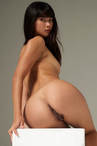 Young Asian seductress flaunts her divine nubile body in the photo studio