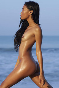 Magnificent Asian doll shows off her luscious tanned body on the beach