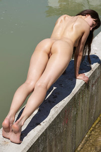 Naked and all natural brunette flashing with her curves outdoors