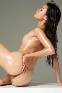Small titted newcomer poses naked without any hint of inhibition