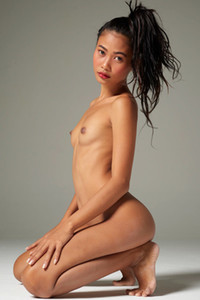 Exotic chick Hiromi showcasing her slim body packed in blue panties and black top
