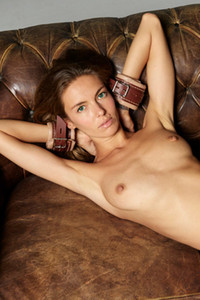 Tall slim Ukrainian chick posing naked on the leather couch