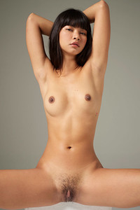 Dark haired doll bares her seductive body while posing