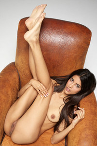 Exotic Latin beauty Clau shows her assets on the leather armchair