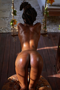 Exotic ebony beauty shows us her luscious pussy and lickable big boobs
