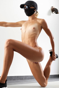 Small titted blonde presents her athletic figure while stretching out