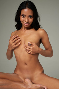 Black haired seductive damsel Chloe exposes the natural assets of her sexy Asian body