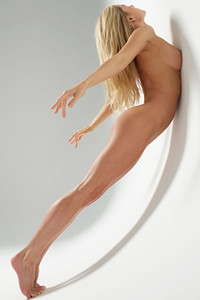 Breathtaking beauty bares her slender figure while posing naked for the camera objective