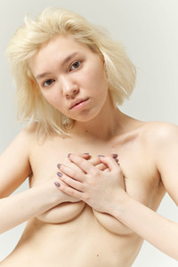 All natural cutie Lily exposing her pale figure with cute titties and shaved pussy