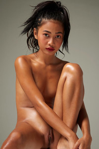 Adorable Asian chick gently revealing all she got as she poses naked