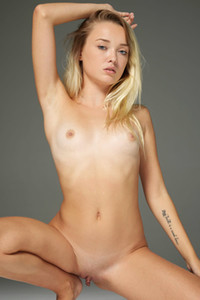 Blonde sweetheart demonstrating her tanlined body and sweet pussy as she poses nude