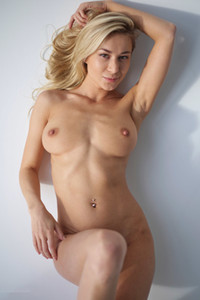 Dazzling blondie flaunts her figure with perfect breasts and round ass